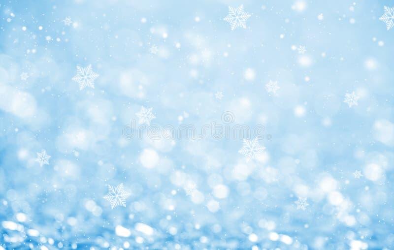 抽象蓝色闪烁bokeh和雪花 图库摄影