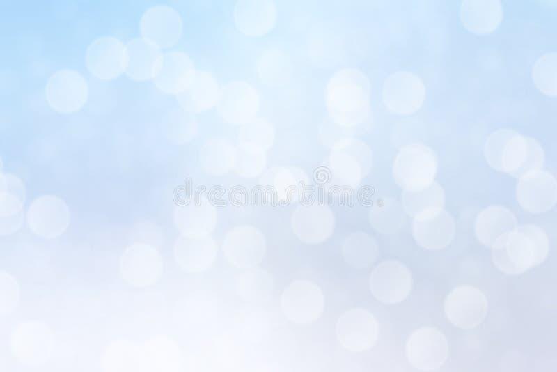 抽象蓝色bokeh光线影响,软的被弄脏的背景 免版税库存照片