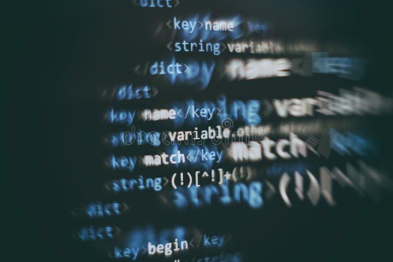 抽象计算机剧本代码 软件开发商编程的代码屏幕  编程打工时间 书面的编码正文 库存图片