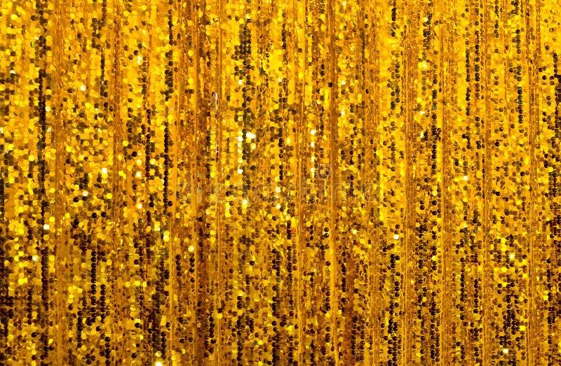 抽象金黄闪烁帷幕背景 库存照片