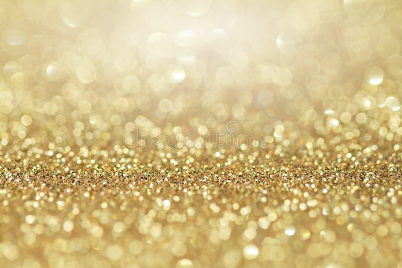 抽象金黄闪烁背景 庆祝和圣诞节背景 免版税图库摄影