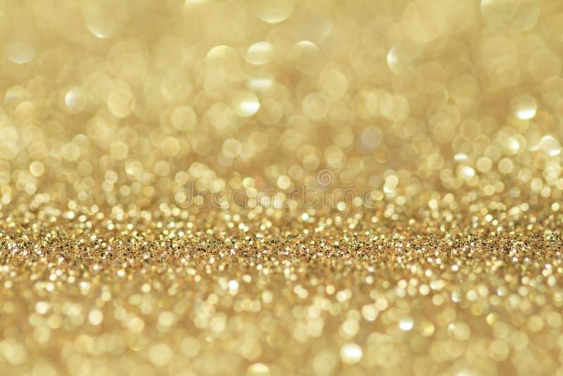 抽象金黄闪烁背景 庆祝和圣诞节背景 库存照片