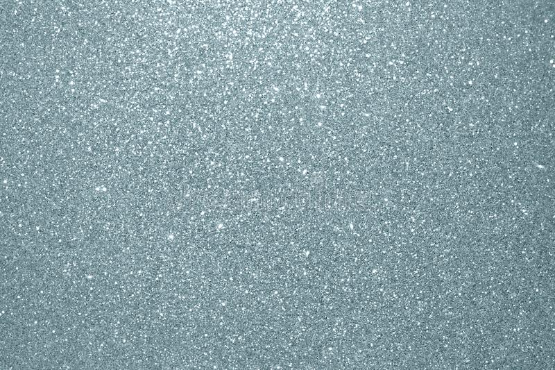 抽象银色闪烁纹理背景 闪烁的银色五谷或光亮的微粒有闪耀的光线影响背景fo 库存图片