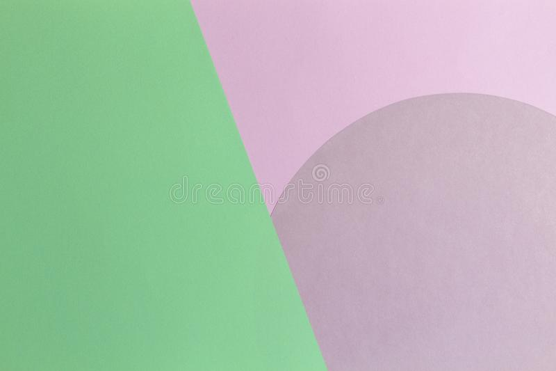 抽象颜色纸背景 围绕圈子形状几何构成的粉红彩笔和浅绿色的颜色 顶视图 免版税库存图片