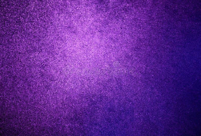 抽象紫色发光的闪烁背景 免版税库存照片