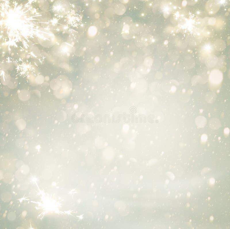 抽象Defocused圣诞节金黄假日背景的闪烁