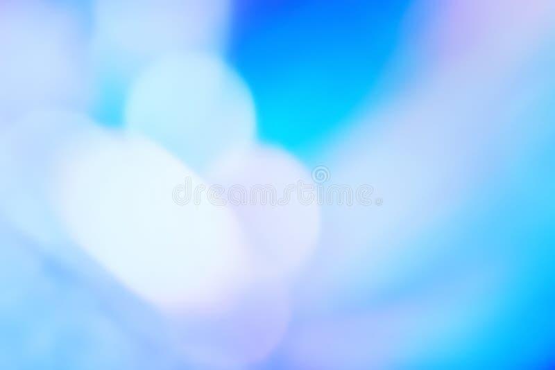 抽象gradiant与被弄脏的bokeh光线影响的墙纸全息照相的箔 库存照片