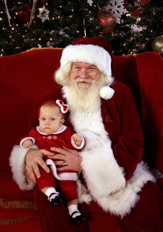 担心的婴孩和圣诞老人 免版税库存图片