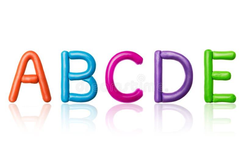 拉丁字母的信件由色的彩色塑泥制成 库存照片