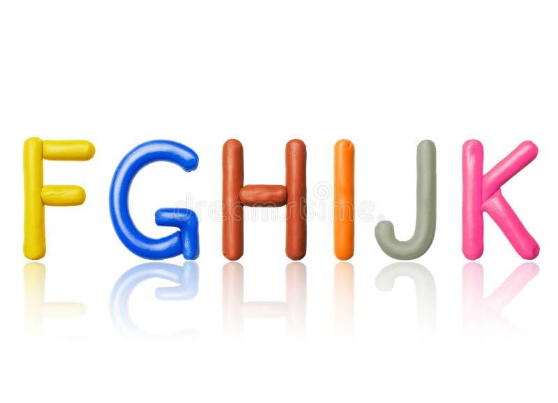 拉丁字母的信件由色的彩色塑泥制成 免版税库存照片