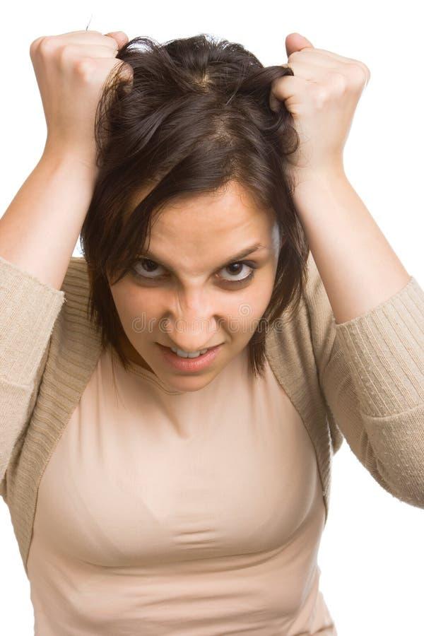 拉妇女的头发 免版税图库摄影