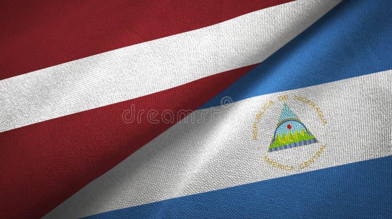 拉脱维亚和尼加拉瓜两旗子纺织品布料,织品纹理 库存例证