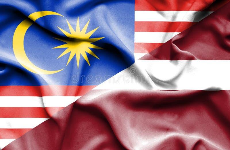 拉脱维亚和马来西亚的挥动的旗子 库存例证