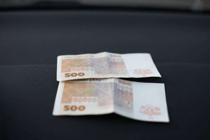 拉脱维亚货币的拉特银币 库存照片