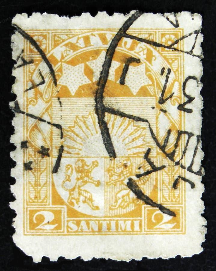 拉脱维亚邮票显示胳膊和星Vidzeme、Kurzeme和Latgale的,大约1931年 库存照片