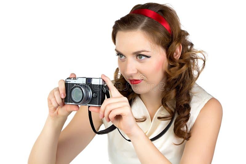 拍摄的妇女的照片有减速火箭的照相机的 免版税库存照片