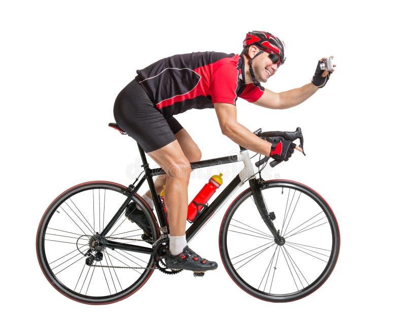 拍摄的快乐的骑自行车者 库存图片