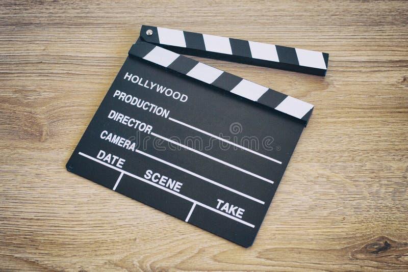 拍板,在木头的电影拍板 免版税图库摄影