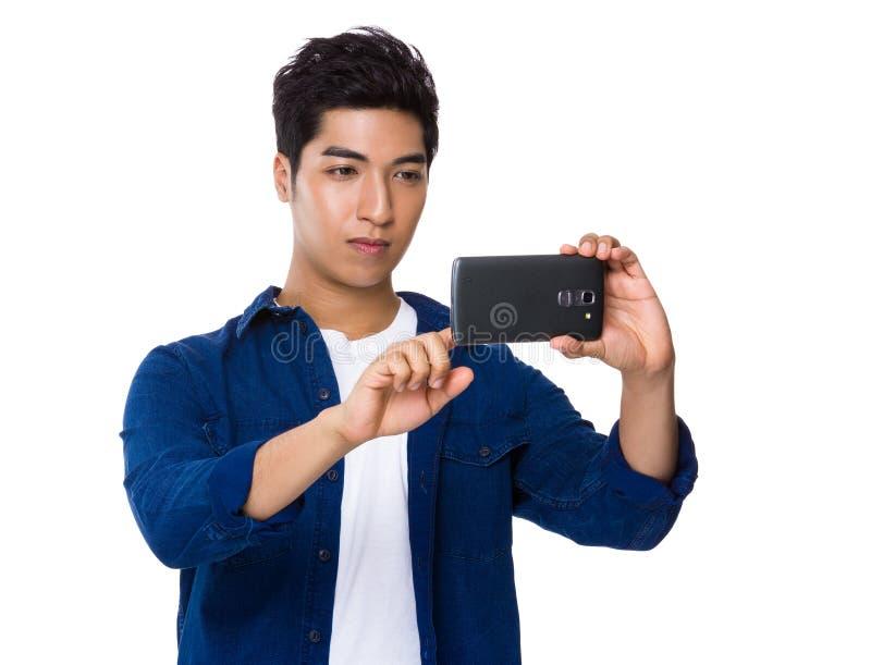 拍照片的人用途手机 库存图片