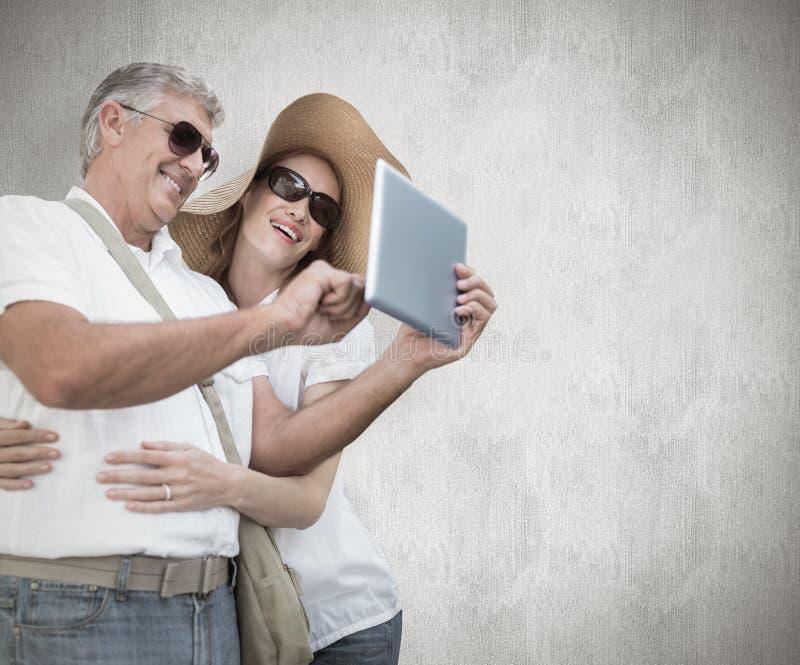 拍照片的假期的夫妇的综合图象 库存照片