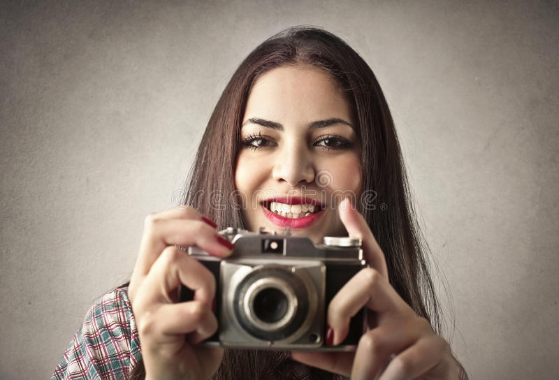 拍照片的夫人 免版税库存照片