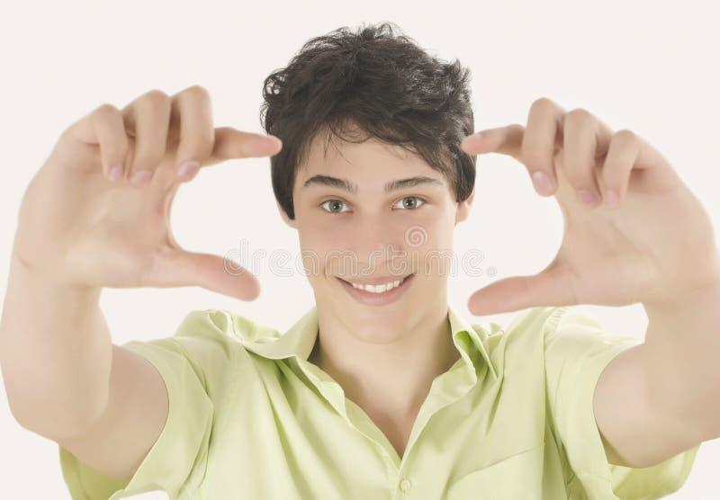 拍selfie照片的愉快的年轻人 免版税库存图片