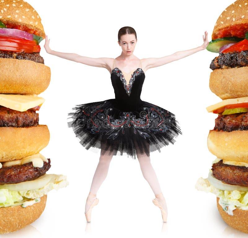 拒绝大汉堡的亭亭玉立的balerina停留适合 图库摄影