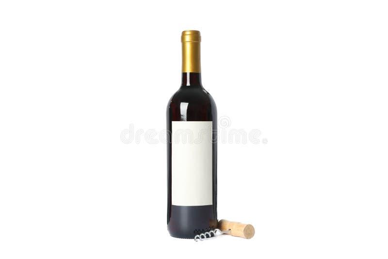拔塞螺旋和瓶有在白色隔绝的红酒的 库存图片