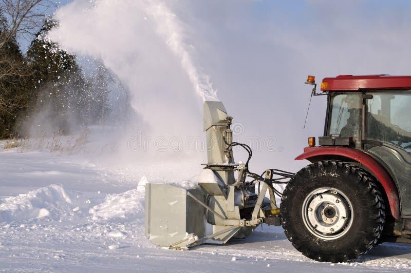 拖拉机吹雪机 免版税库存照片