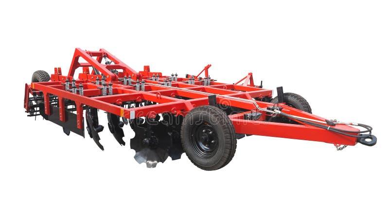 拖拉机的红色新的农厂耕地机犁被隔绝在白色 免版税库存图片