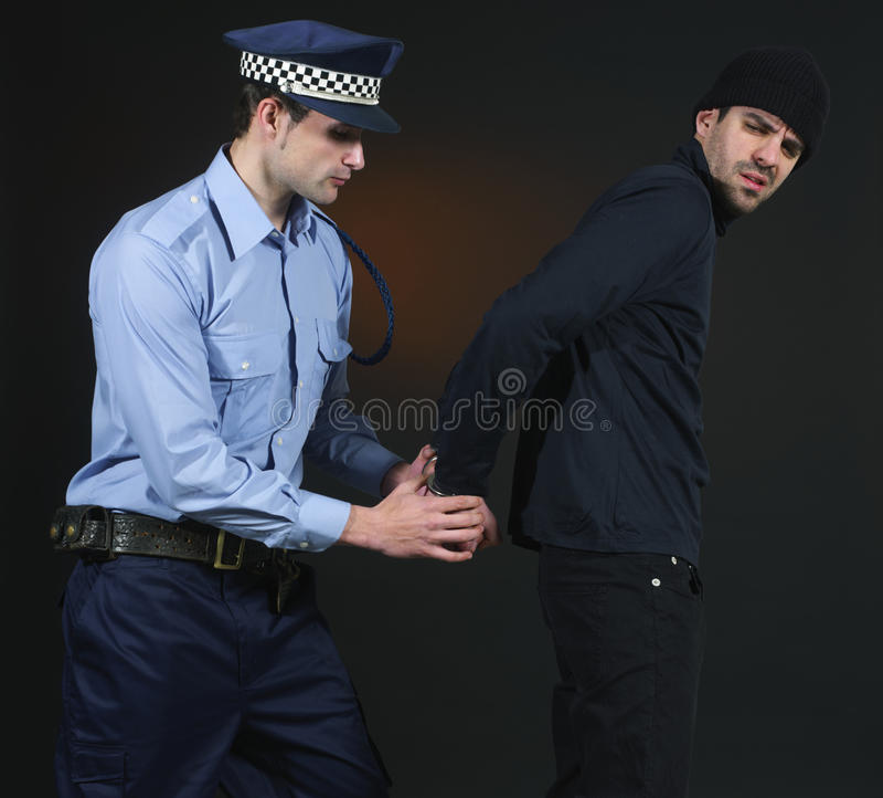 拘捕官员警察窃贼 免版税库存图片