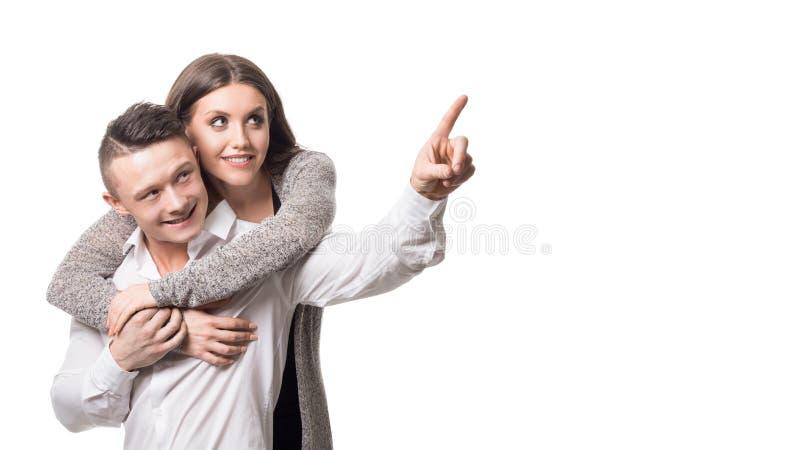 拥抱她的丈夫的美丽的年轻女人 考虑未来 家族关系概念 库存图片