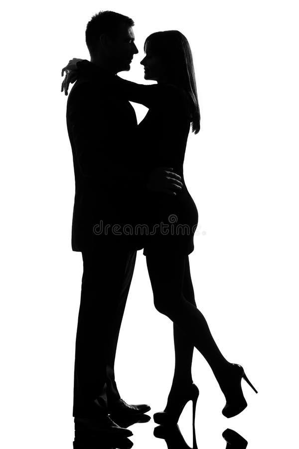 拥抱恋人的夫妇供以人员一名柔软妇&# 免版税库存图片