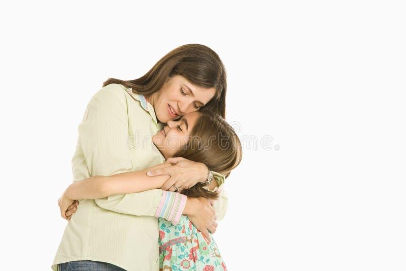 拥抱母亲的女儿 图库摄影