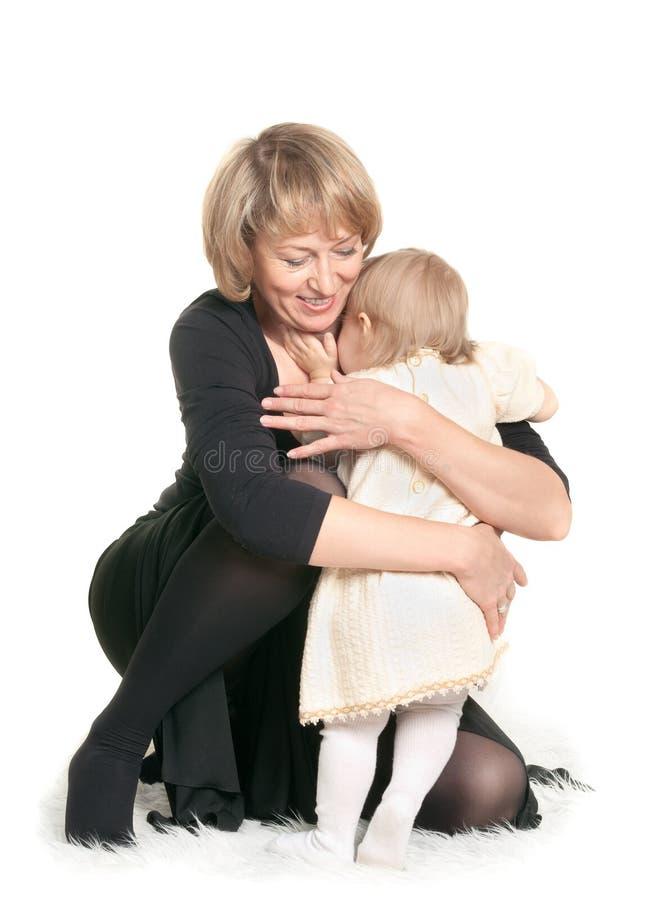 拥抱的孙女祖母少许 图库摄影