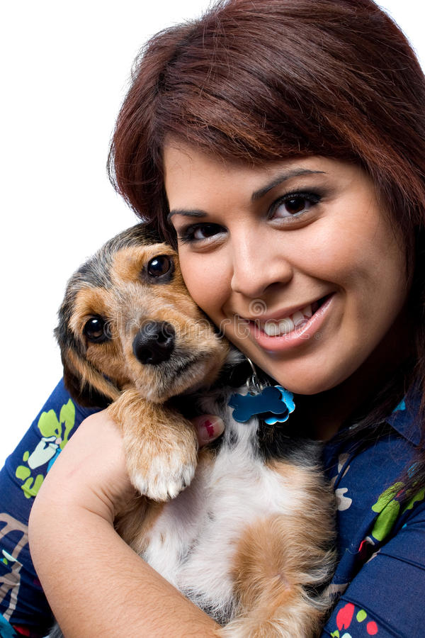 拥抱的小狗妇女 库存照片