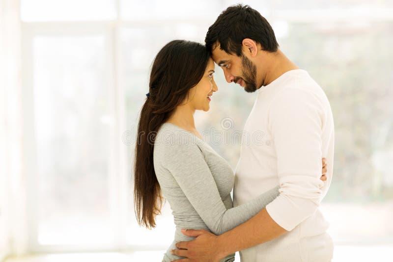 拥抱年轻人的夫妇 库存图片