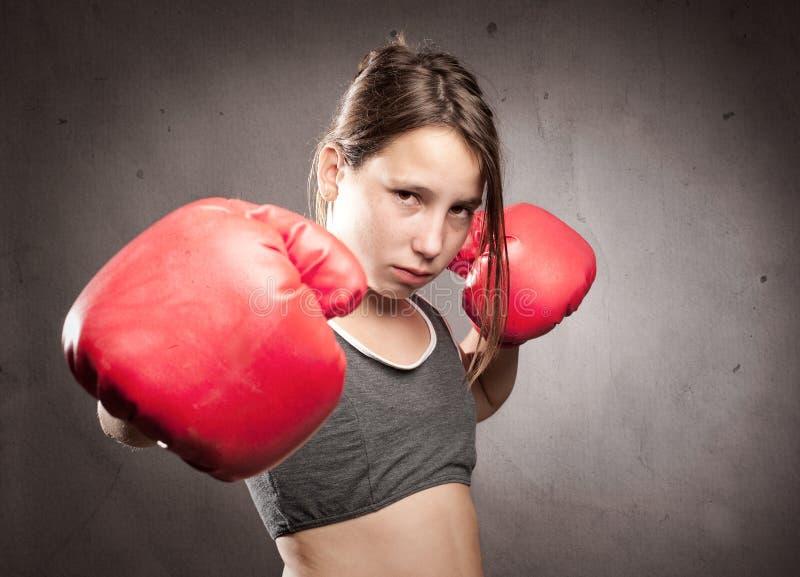 年轻拳击手女孩 免版税库存图片