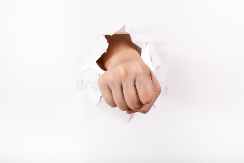 拳头的直接看法猛击纸 免版税库存照片