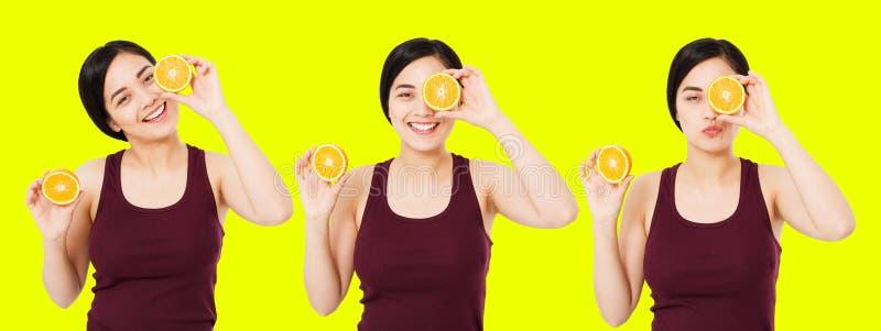拼贴画愉快的日语,亚裔妇女,拿着桔子的片断女孩隔绝在黄色背景,皮肤护理化妆概念,拷贝 库存照片