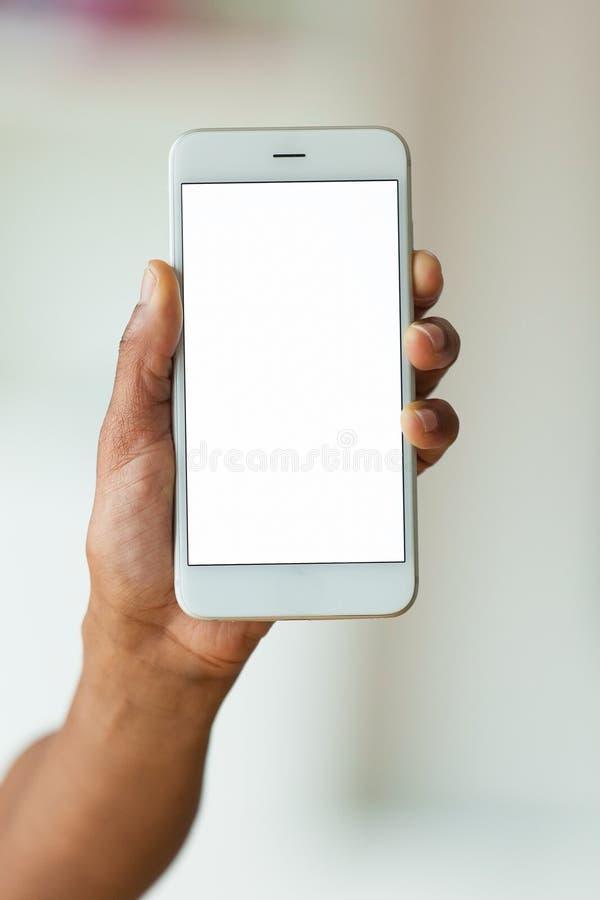 拿着一个有触觉的流动智能手机- Bl的非裔美国人的人 库存图片