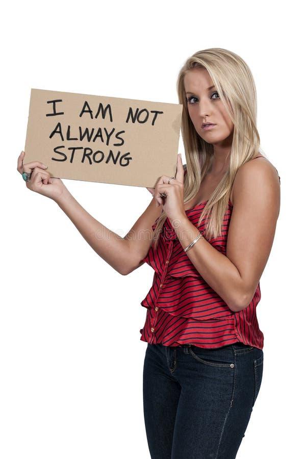 拿着一个激动人心的标志的妇女 免版税图库摄影