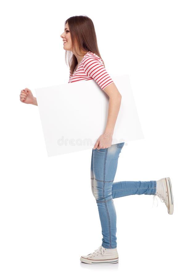 Download 拿着一个白板的偶然少妇 库存照片. 图片 包括有 姿势, 现代, 照亮, 人员, 女孩, 愉快, 快乐, 设计 - 30335896