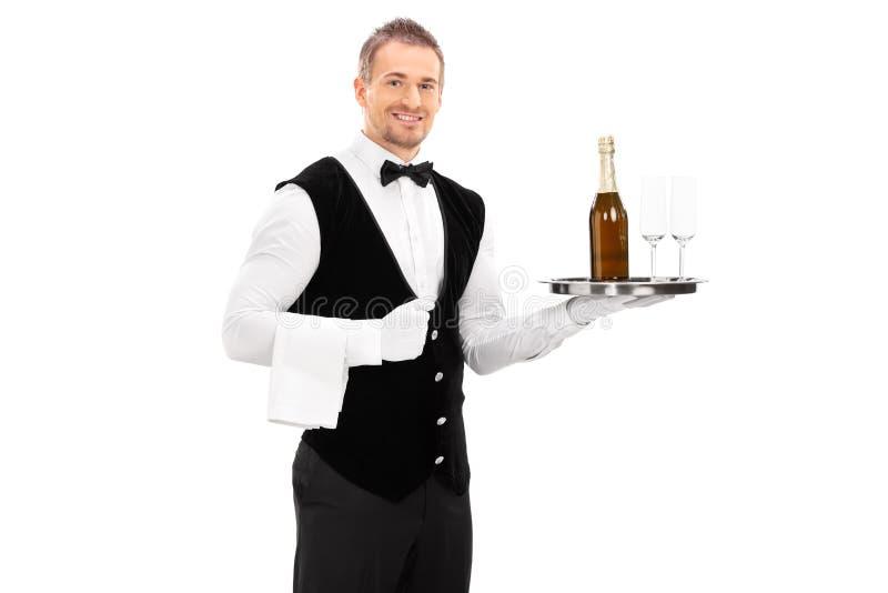 拿着一个盘子用对此的香槟的侍者 库存图片