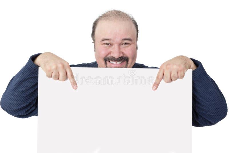 拿着一个空白的白色标志的有动机的商人 免版税库存图片