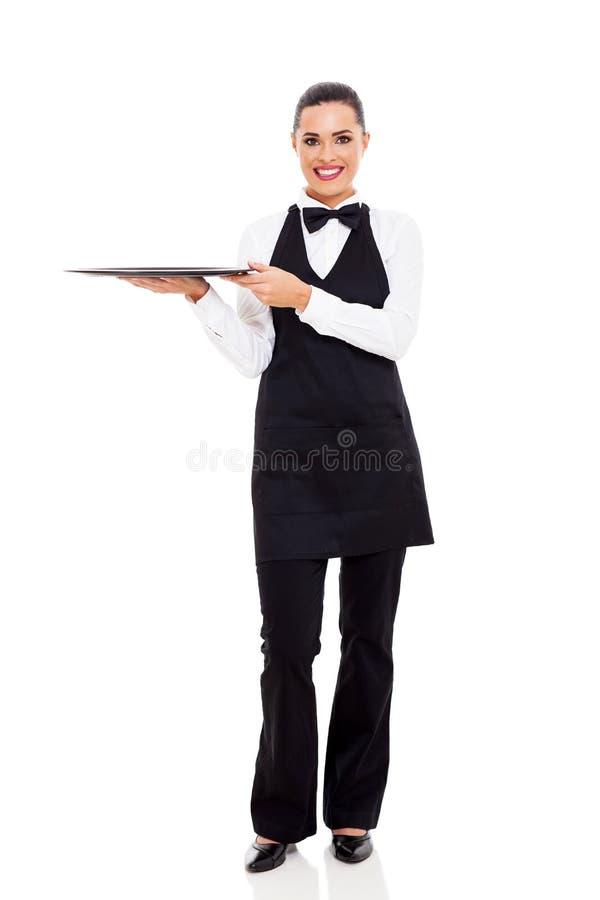 逗人喜爱的年轻女服务员 免版税库存照片