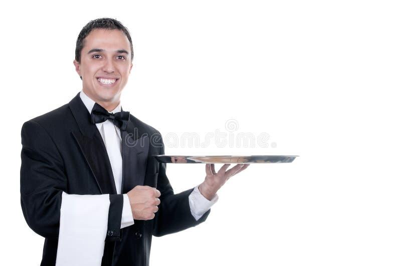 拿着一个空的盘的诉讼的年轻人 免版税库存图片