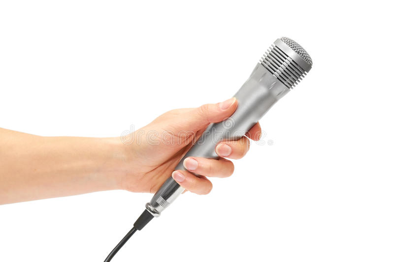 拿着一个立体声话筒的女性手记录歌曲或卡拉OK演唱 库存图片