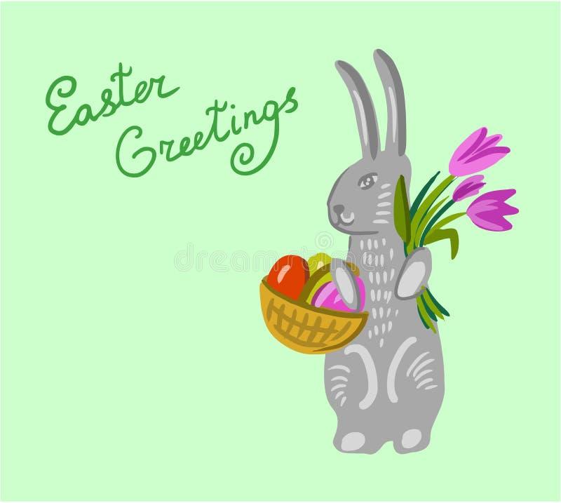 拿着一个篮子用大逾越节鸡蛋的复活节兔子 免版税图库摄影