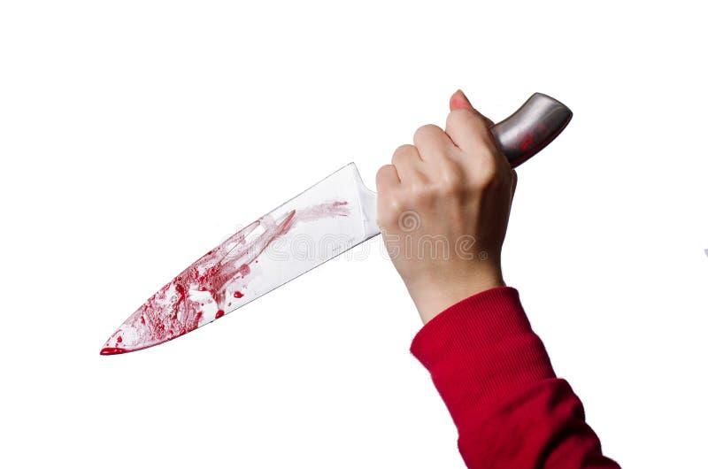 拿着一把血淋淋的刀子的手 免版税库存照片